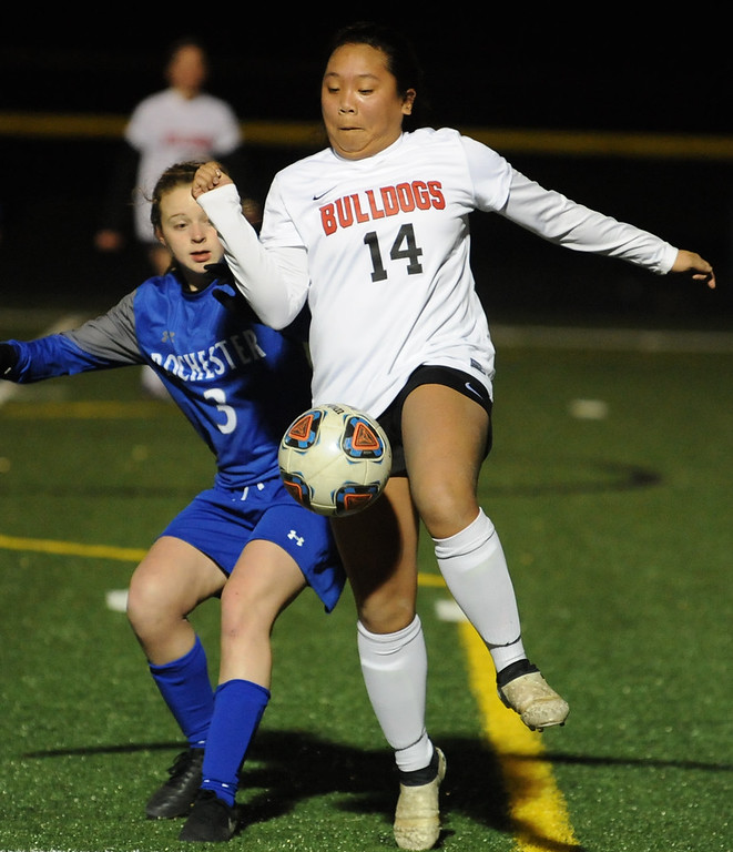 . Julienne Ciacico (14) of Romeo controls the ball in front of Rochester\'s Sidney Swart (3) during the OAA/MAC match played on Monday March 26, 2018 at Romeo High School.  The Bulldogs lost to the Falcons 2-0.  (Digital First Media photo by Ken Swart)
