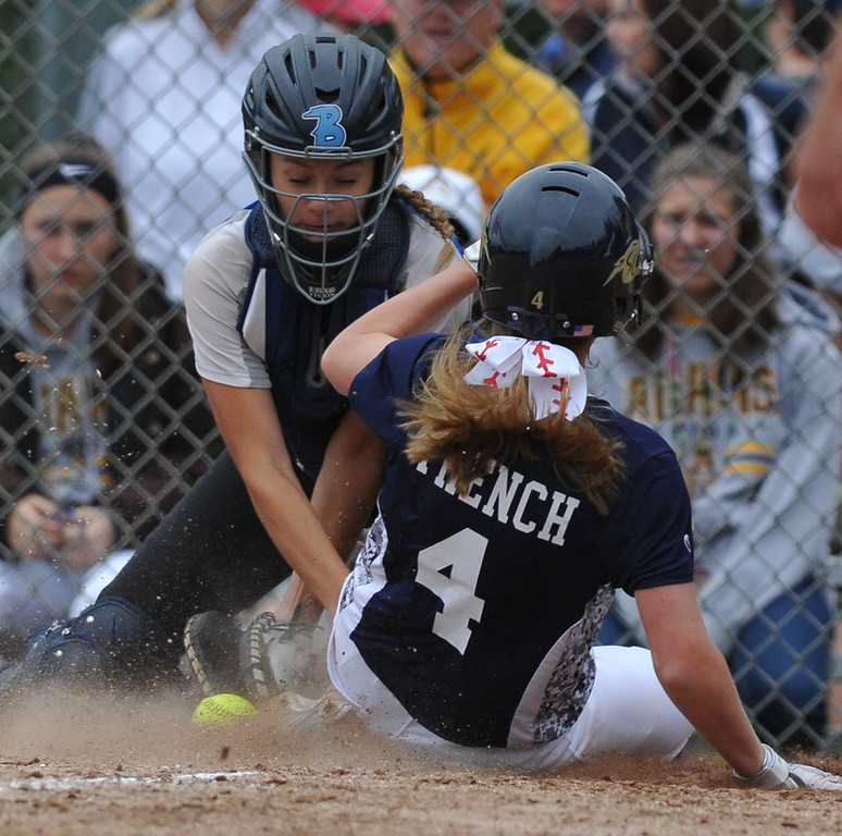 . Stoney Creek\'s Brooke French slides safely into home as Utica Eisenhower\'s Mazie Lawler tries for the tag during the MHSAA D1 district played at Stoney Creek HS on Saturday June 2, 2018.  The Cougars defeated the Eagles 8-1 in the semis and Adams 2-1 in the final.  (Digital First Media photo by Ken Swart)