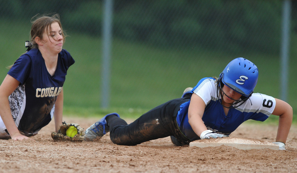 . Utica Eisenhower\'s Cheyenne Smith dives safely back into second base as Stoney Creek\'s Emma Beyer tries for the tag during the MHSAA D1 district played at Stoney Creek HS on Saturday June 2, 2018.  Stoney defeated the Eagles 8-1 in the semi-final.  (Digital First Media photo by Ken Swart)