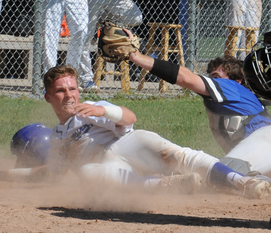 . Eisenhower\'s Jake Miller is tagged out by Rochester catcher Marty O\'Neill during the MHSAA D1 baseball district played at Stoney Creek HS on Saturday June 2, 2018.  The Eagles defeated Rochester 9-2 to win the title.   (Digital First Media photo by Ken Swart)