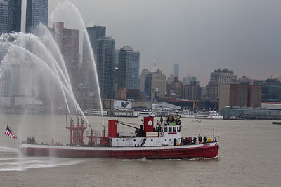 The John J. Harvey, a retired NYC fireboat welcomes visitors as only a fireboat can.