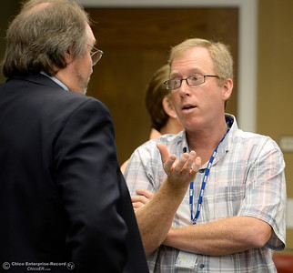 At right, DWR Representative Eric See talks with ORAC Chair Kevin Zeitler prior to a meeting Friday.   Members of the Oroville Recreation Advisory Committee ORAC talked with DWR representatives during the 196th meeting of the group at the Oroville City Council Chambers in Oroville, Calif. Friday July 21, 2017. Following the meeting agenda schedule the group discussed tourism and recreation, lake conditions and projections, recreational projects status and voted on a request to delay the FERC license. (Bill Husa -- Enterprise-Record)