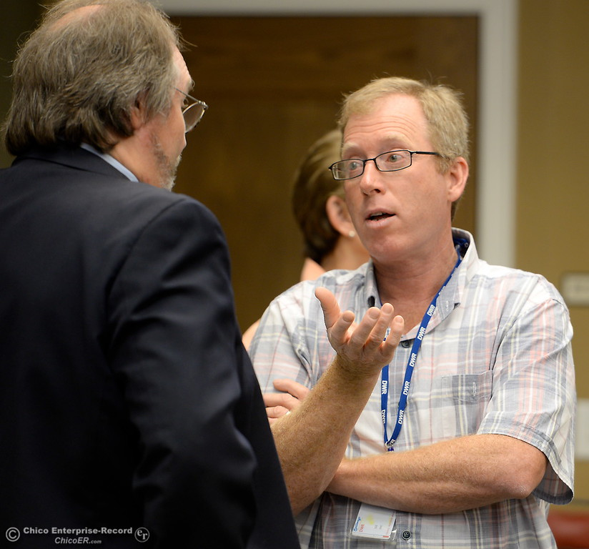 . At right, DWR Representative Eric See talks with ORAC Chair Kevin Zeitler prior to a meeting Friday.   Members of the Oroville Recreation Advisory Committee ORAC talked with DWR representatives during the 196th meeting of the group at the Oroville City Council Chambers in Oroville, Calif. Friday July 21, 2017. Following the meeting agenda schedule the group discussed tourism and recreation, lake conditions and projections, recreational projects status and voted on a request to delay the FERC license. (Bill Husa -- Enterprise-Record)