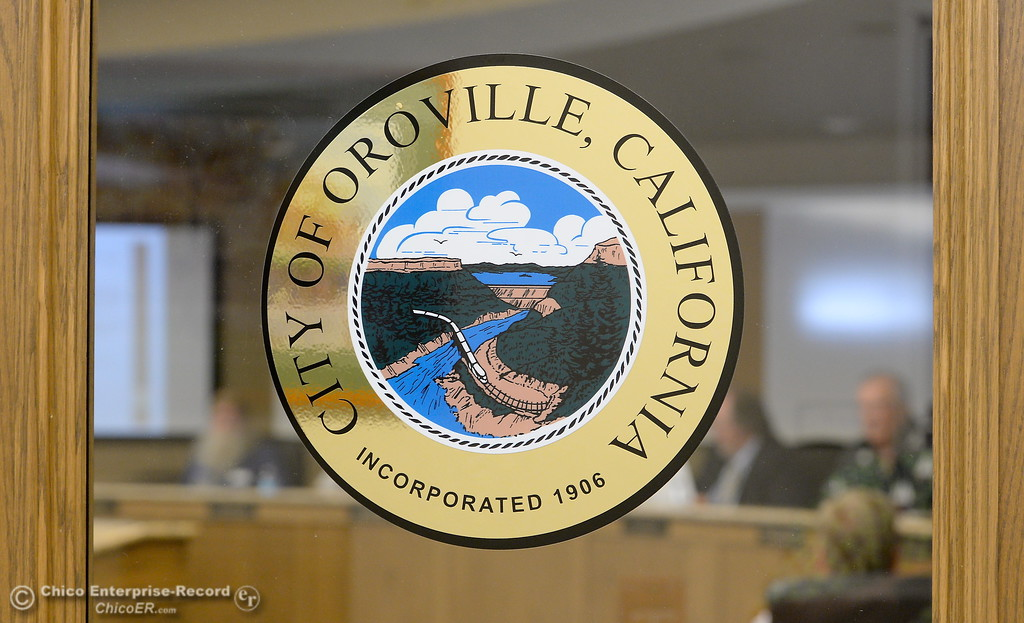 . A City of Oroville Logo is seen on the door to the Oroville City Council Chambers in Oroville, Calif. Friday July 21, 2017. Sign (Bill Husa -- Enterprise-Record)