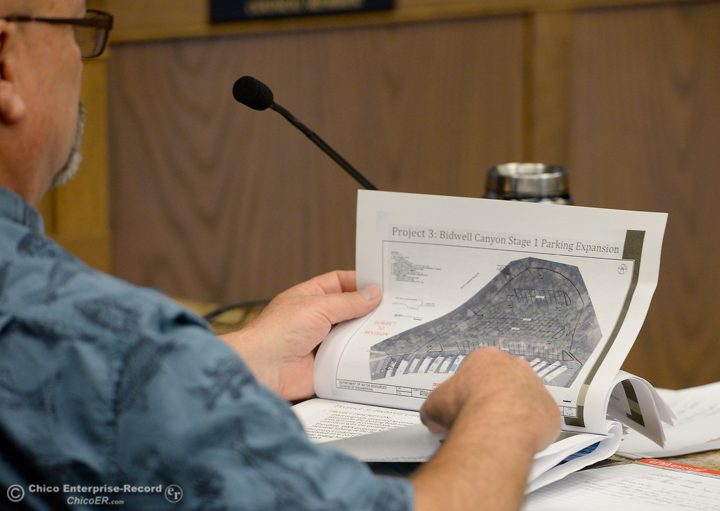 . DWR Representative Oroville Field Division Kevin Dossey looks at paperwork while members of the Oroville Recreation Advisory Committee ORAC who talked with DWR representatives during the 196th meeting of the group at the Oroville City Council Chambers in Oroville, Calif. Friday July 21, 2017. Following the meeting agenda schedule the group discussed tourism and recreation, lake conditions and projections, recreational projects status and voted on a request to delay the FERC license. (Bill Husa -- Enterprise-Record)