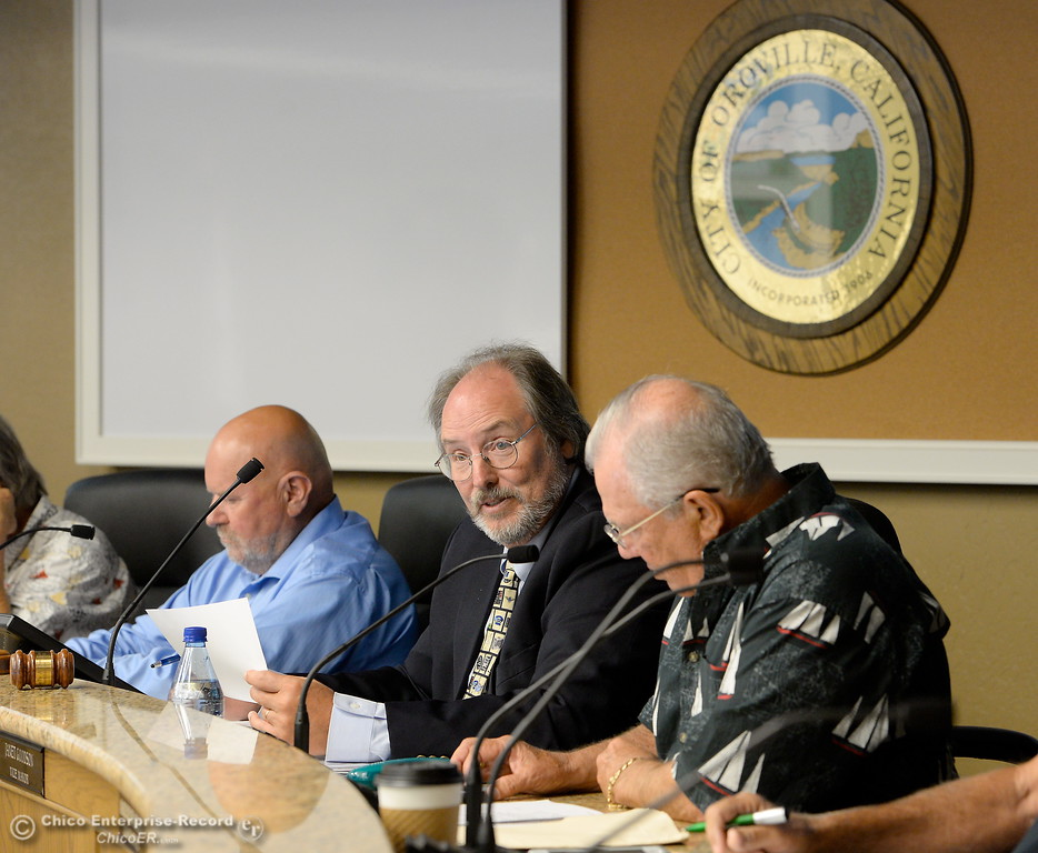 . Oroville Recreation Advisory Committee/ORAC Chair Kevin Zeitler, center, talks with DWR representatives during the 196th meeting of the group at the Oroville City Council Chambers in Oroville, Calif. Friday July 21, 2017. Following the meeting agenda schedule the group discussed tourism and recreation, lake conditions and projections, recreational projects status and voted on a request to delay the FERC license. (Bill Husa -- Enterprise-Record)