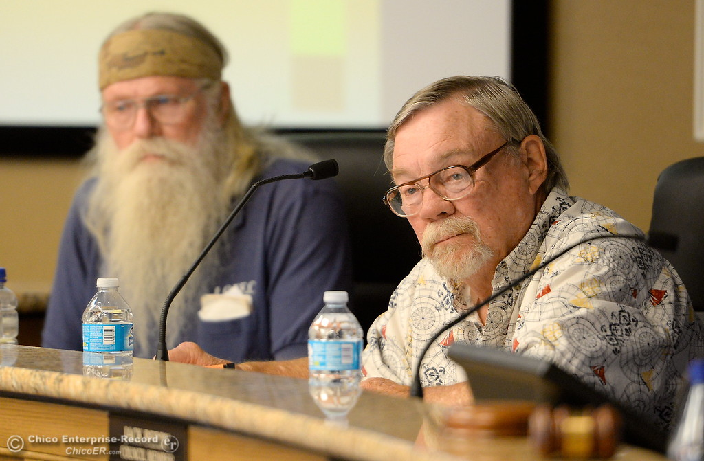 . Members of the Oroville Recreation Advisory Committee Doug Poppelreiter left and Wade Hough, right, talk with DWR representatives during the 196th meeting of the group at the Oroville City Council Chambers in Oroville, Calif. Friday July 21, 2017. Following the meeting agenda schedule the group discussed tourism and recreation, lake conditions and projections, recreational projects status and voted on a request to delay the FERC license. (Bill Husa -- Enterprise-Record)