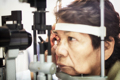Examining patient with slit lamp