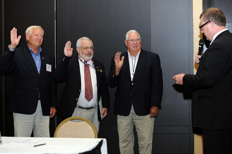 Ohio Rural Electric Cooperatives<br /> Annual Meeting<br /> August 11, 2015<br /> Chair Ed Sanders (Pioneer REC), Vice Chair Jack Schmidt (Energy Co-op) and Secretary/Treasurer Gene McCluer (Mid-Ohio) taking the oath of office with counsel Kurt Helfrich