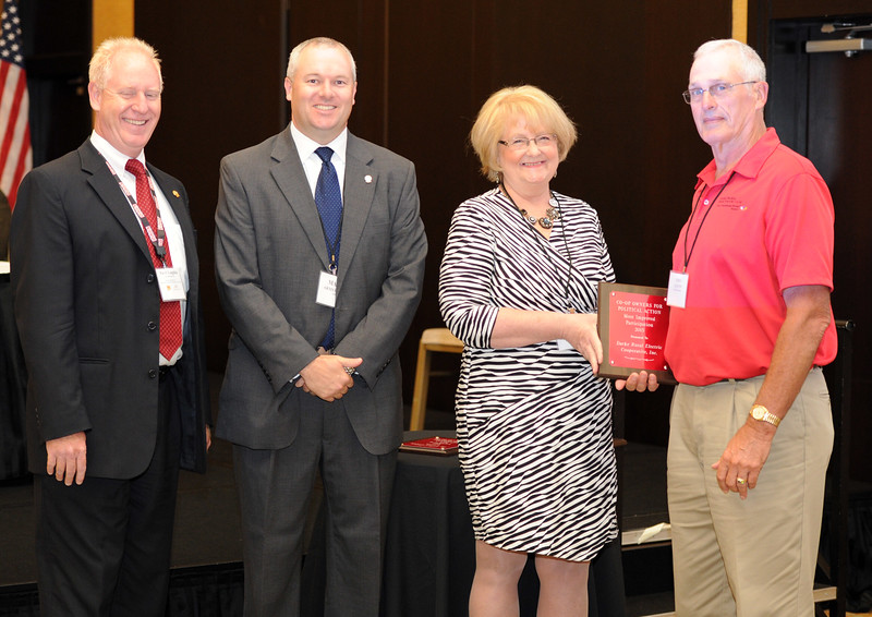 Ohio Rural Electric Cooperatives<br /> Annual Meeting<br /> August 11, 2015<br /> Century Plaque ACRE/OECPAC<br /> Pat O'Loughlin (OREC President and CEO), Marc Armstrong (OREC Director Government Affairs), John Eaton (Lorain-Medina) and April Bordas (Ohio ACRE Chair).
