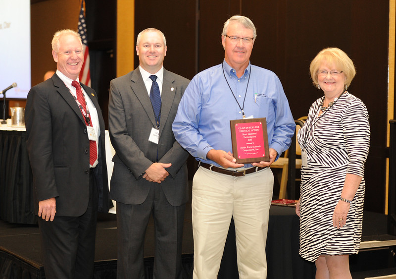 Ohio Rural Electric Cooperatives<br /> Annual Meeting<br /> August 11, 2015<br /> Century Plaque ACRE/OECPAC<br /> Pat O'Loughlin (OREC President and CEO), Marc Armstrong (OREC Director Government Affairs), Randy Sprang (Holmes-Wayne) and April Bordas (Ohio ACRE Chair).