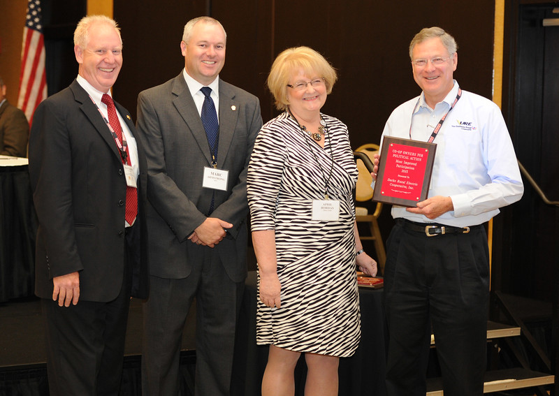 Ohio Rural Electric Cooperatives<br /> Annual Meeting<br /> August 11, 2015<br /> Century Plaque ACRE/OECPAC<br /> Pat O'Loughlin (OREC President and CEO), Marc Armstrong (OREC Director Government Affairs), April Bordas (Ohio ACRE Chair) and Jeff Wilson (Union REC).