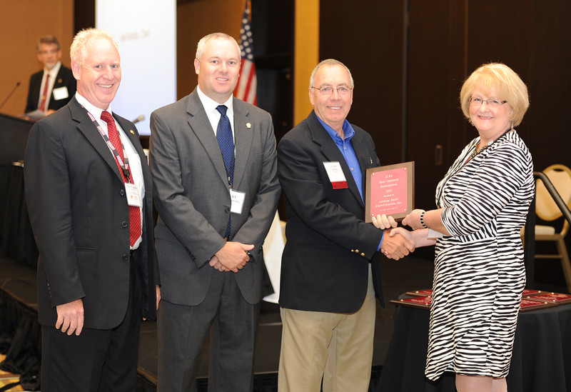 Ohio Rural Electric Cooperatives<br /> Annual Meeting<br /> August 11, 2015<br /> ACRE Most Improved Award<br /> Pat O'Loughlin (OREC President and CEO), Marc Armstrong (OREC Director Government Affairs), Nelson Smith (The Energy Cooperative) and April Bordas (Ohio ACRE Chair).