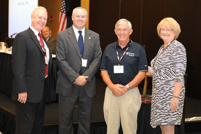 Ohio Rural Electric Cooperatives<br /> Annual Meeting<br /> August 11, 2015<br /> President's Club ACRE/OECPAC Century Plaque<br /> Pat O'Loughlin (OREC President and CEO), Marc Armstrong (OREC Director Government Affairs), Richard Kritzler (Mid-Ohio Energy) and April Bordas (Ohio ACRE Chair).