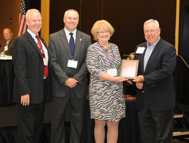 Ohio Rural Electric Cooperatives<br /> Annual Meeting<br /> August 11, 2015<br /> Century Plaque ACRE/OECPAC<br /> Pat O'Loughlin (OREC President and CEO), Marc Armstrong (OREC Director Government Affairs), April Bordas (Ohio ACRE Chair) and Ken Davis (South Central).