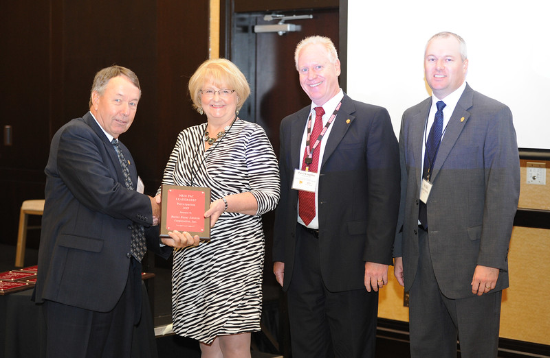 Ohio Rural Electric Cooperatives<br /> Annual Meeting<br /> August 11, 2015<br /> Ohio PAC Leadership Award<br /> Tom McQuiston (Butler REC), April Bordas (Ohio ACRE Chair), Pat O'Loughlin (OREC President and CEO), Marc Armstrong (OREC Director Government Affairs).