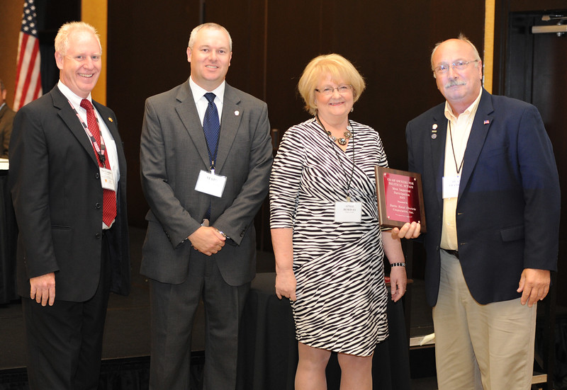 Ohio Rural Electric Cooperatives<br /> Annual Meeting<br /> August 11, 2015<br /> Century Plaque ACRE/OECPAC<br /> Pat O'Loughlin (OREC President and CEO), Marc Armstrong (OREC Director Government Affairs), April Bordas (Ohio ACRE Chair) and Duane Frankart (North Central).