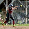 Oarkmont Regional High School softball played Groton dunstable Regional High School on Tuesday afternoon in Ashburnham. GDRHS player Cassidy Heuligns tries to punt during action in the game. SENTINEL & ENTERPRISE/JOHN LOVE