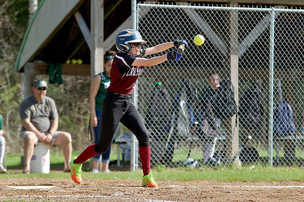 . Oarkmont Regional High School softball played Groton dunstable Regional High School on Tuesday afternoon in Ashburnham. GDRHS player Cassidy Heuligns tries to punt during action in the game. SENTINEL & ENTERPRISE/JOHN LOVE