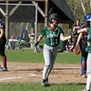 Oarkmont Regional High School softball played Groton dunstable Regional High School on Tuesday afternoon in Ashburnham. ORHS player Emma Simkewicz is congratulated by her teammate Jaz Concannon after she scored a run during action in the game. SENTINEL & ENTERPRISE/JOHN LOVE