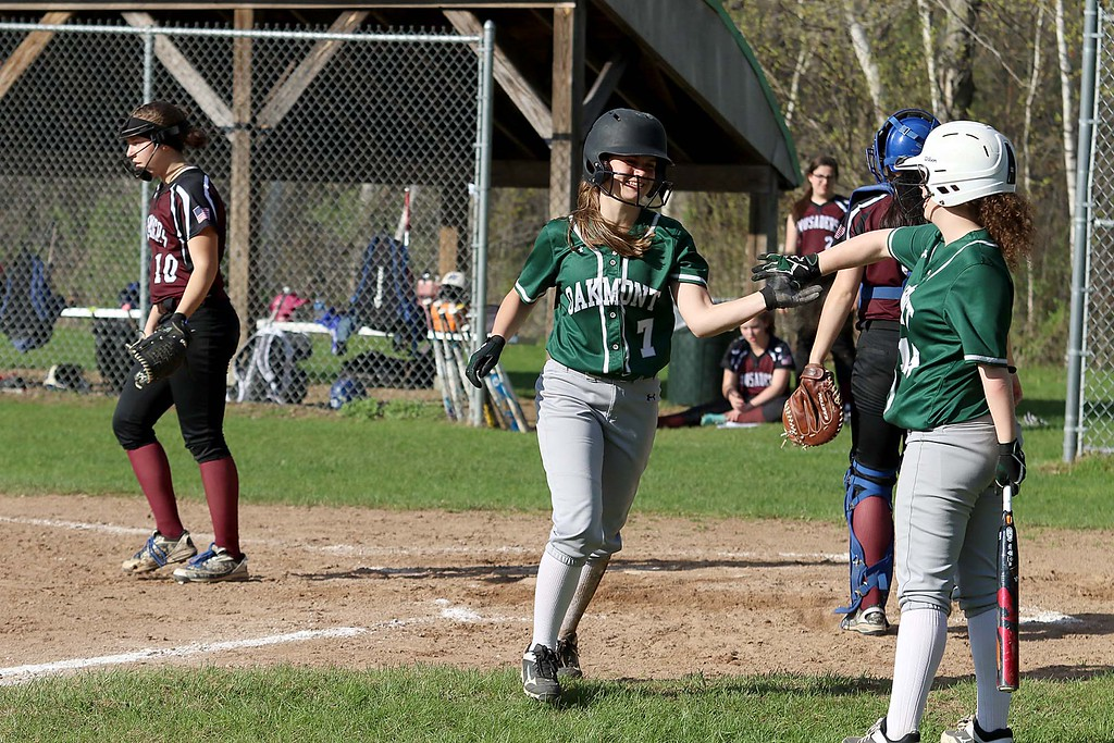 . Oarkmont Regional High School softball played Groton dunstable Regional High School on Tuesday afternoon in Ashburnham. ORHS player Emma Simkewicz is congratulated by her teammate Jaz Concannon after she scored a run during action in the game. SENTINEL & ENTERPRISE/JOHN LOVE