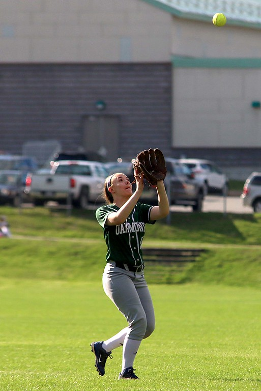 . Oarkmont Regional High School softball played Groton dunstable Regional High School on Tuesday afternoon in Ashburnham. ORHS player Jess Coleman gets under the ball to make a catch during action in the game. SENTINEL & ENTERPRISE/JOHN LOVE