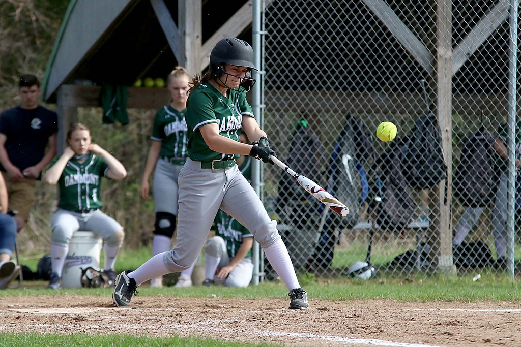 . Oarkmont Regional High School softball played Groton dunstable Regional High School on Tuesday afternoon in Ashburnham. ORHS player Emma Simkewicz get a piece of the ball during action in the game. SENTINEL & ENTERPRISE/JOHN LOVE