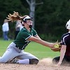 Oarkmont Regional High School softball played Groton dunstable Regional High School on Tuesday afternoon in Ashburnham. ORHS shortstop Sarah Richard ties to tag out GDRHS player Lauren Thorburn as she steals second during action in the game. SENTINEL & ENTERPRISE/JOHN LOVE