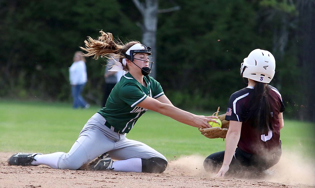 . Oarkmont Regional High School softball played Groton dunstable Regional High School on Tuesday afternoon in Ashburnham. ORHS shortstop Sarah Richard ties to tag out GDRHS player Lauren Thorburn as she steals second during action in the game. SENTINEL & ENTERPRISE/JOHN LOVE