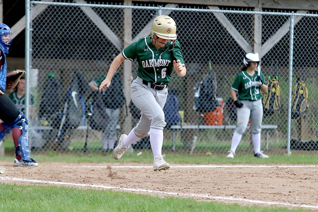 . Oarkmont Regional High School softball played Groton dunstable Regional High School on Tuesday afternoon in Ashburnham. ORHS player Jenna Duval takes off down the first baseline after getting a hit in the game. SENTINEL & ENTERPRISE/JOHN LOVE