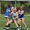 Oakmont Regional High School girls lacrosse played Lunenburg Middle High School on Tuesday afternoon in Ashburnham. ORHS's Jackie Beatty is covered by LMHS players Elizabeth Walsh and Alizah Raboin.  SENTINEL & ENTERPRISE/JOHN LOVE