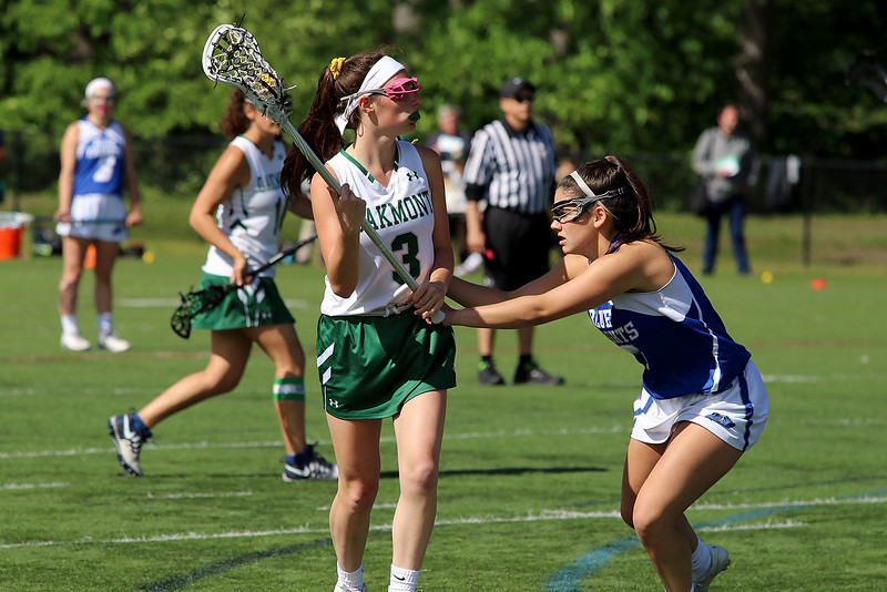 Oakmont Regional High School girls lacrosse played Lunenburg Middle High School on Tuesday afternoon in Ashburnham. Audrey Dolan looks around for an open teammate as she is covered by LMHS player Kelly Gearin. SENTINEL & ENTERPRISE/JOHN LOVE