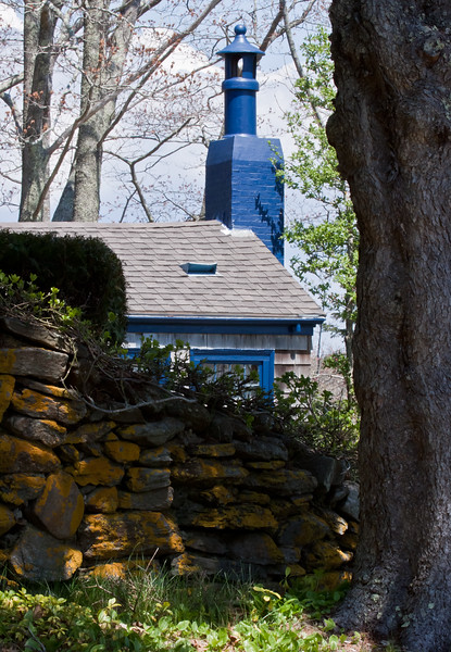 Victorian chimney topper, blue cottage with lichen covered stone wall