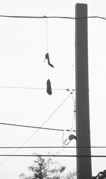 Key West Florida is a real party town. Some young lady lost her shoes on the power lines. Oh the power of the party!