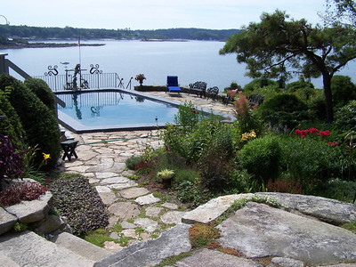 stone patios, perennial gardens, saltwater pool overlooking Casco Bay, Totman Cove