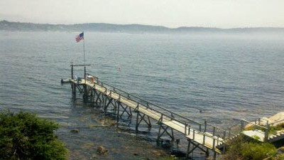 pier at high tide. Striped bass, flounder, Blue fish, mackerel and other sport fish are plentiful in the cove and can be caught from the end of the pier.