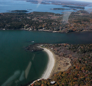 aerial views of Greyledge in late autumn, Bailey Beach, Small Point in the foreground. Sebasco Harbor in the background, all Casco Bay. Sebasco Harbor Resort has a large, deep water mooring field for those visiting by boat.