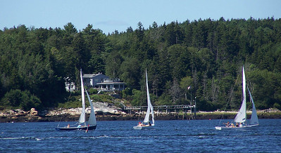 Greyledge (and bedrock outcropping giving the property its name) viewed from east across Totman Cove. Small Point One Design sail races take place twice weekly throughout the summer. Totman Cove hosts abundant water sports including  sailing, tubing and fishing.