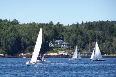 Greyledge (and bedrock outcropping giving the property its name) viewed from east across Totman Cove. Small Point One Design sail races take place twice weekly throughout the summer. Totman Cove hosts abundant water sports including  sailing, water skiing, tubing and fishing.