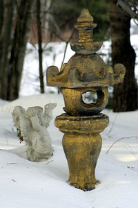 figures in the snow, odd, abstract wooden object with concrete angel gazing upward with arms uplifted, Wiscassett, Maine
