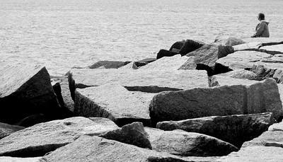 Solitude on the Rockland Breakwater, Rockland Maine, study in black and white.