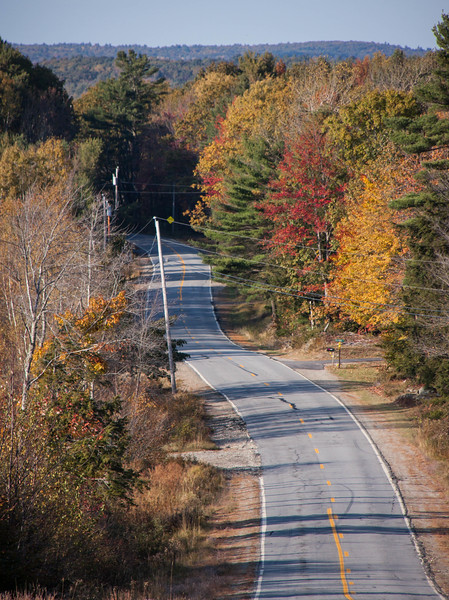 Blinn Hill in autumn, Dresden Maine, fall foliage colors on empty road