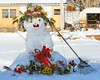 Snow lady in Phippsburg Maine all decked out with flowers and a rake broom. What a gal! Doesn't this just make you smile?
