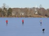 recreational ice skating, family with dog, Labrador retriever on Center Pond Phippsburg Maine, an iconic, classic winter scene, school vacation,