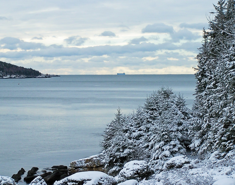 tanker on the horizon, winter panoramic view from Totman Cove to Casco Bay, winter, looking south from West Point side of Phippsburg, Maine to Cape Small on the end of Hermit Island, snow scene