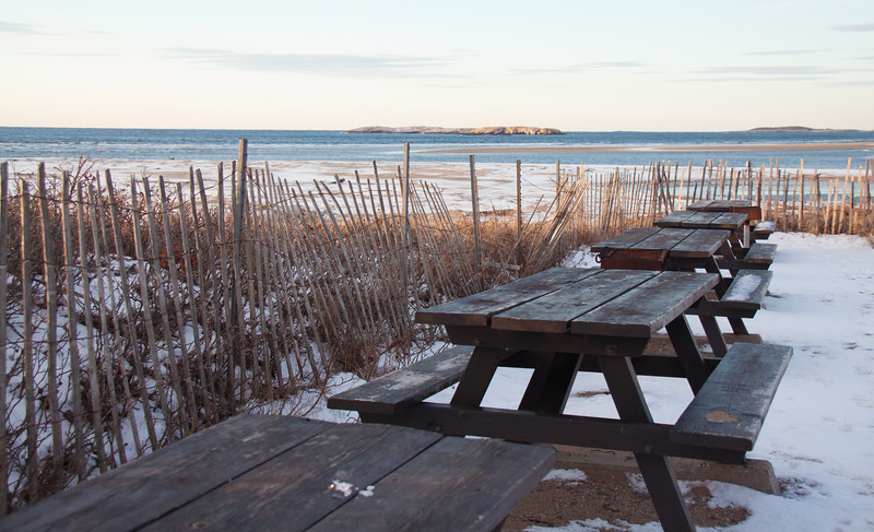 Picnic tables in the snow with snow fencing, Popham Beach State Park, Phippsburg, Maine