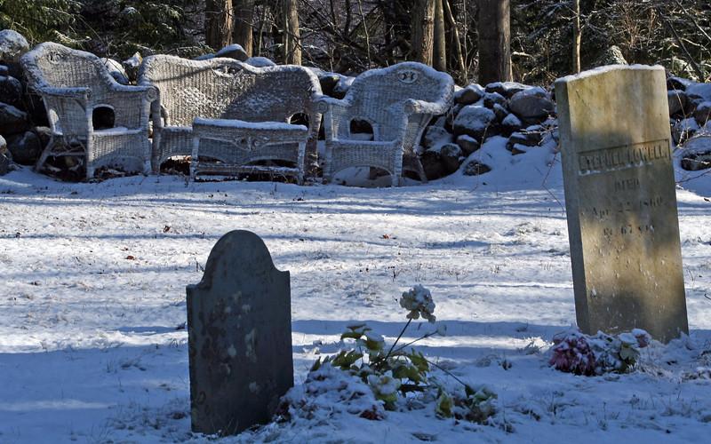 cemetery head stones in the snow with wicker furntiure. ODDDD!