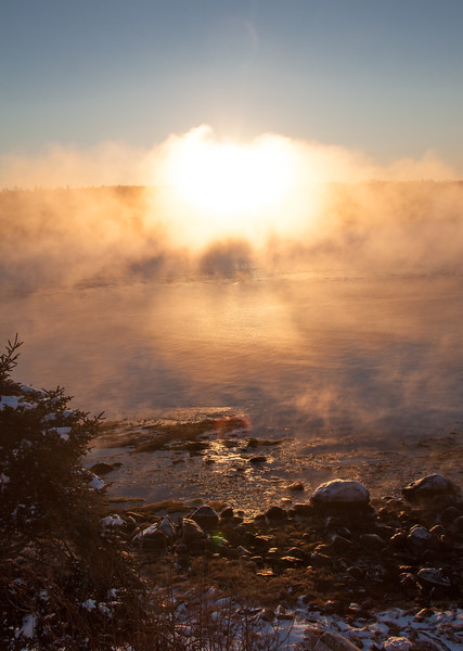Sea smoke rising over Cape Small Harbor, sunrise, Phippsburg, Maine, January.