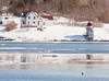 Squirrel Point Lighthouse in winter looking across the Kennebec River from Phippsburg Maine on the Parker Head Road