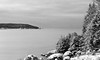 Winter scenic in snow looking from West Point, Phippsburg Maine across Small Point Harbor to Hermit Island